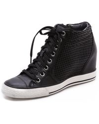 DKNY - Cindy Perf Wedge Sneakers - Lyst
