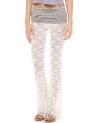 Indah - Lace Flare Trousers - Lyst