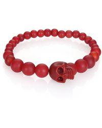 Alexander McQueen Beaded Skull Bracelet red - Lyst