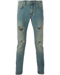 Saint Laurent Distressed Skinny Jeans - Lyst