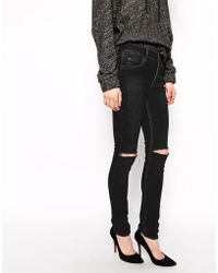 Cheap Monday Tight Skinny Jeans With Rips - Lyst