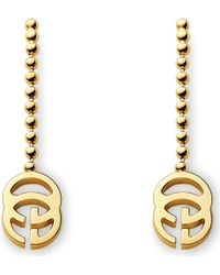 Gucci Running G 18ct Gold Drop Earrings - Lyst