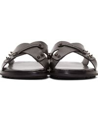 Alexander McQueen Black Leather Studded Cross Sandals - Lyst