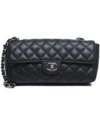 Chanel Pre-Owned Caviar East West Medium Flap Bag - Lyst