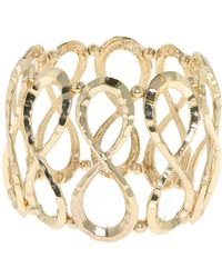 1928 - Gold Hammered Infinity Stretch Bracelet - Lyst