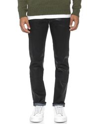 J Brand Tyler Slim Straight Stretch Coated Jeans - Lyst