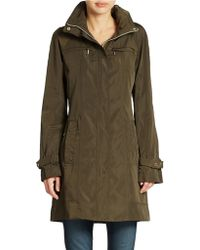 Calvin Klein Packable Rain Repellent Jacket green - Lyst