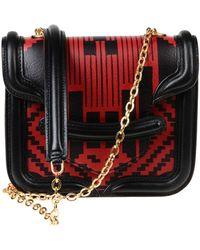 Alexander McQueen Red Under-arm Bags - Lyst