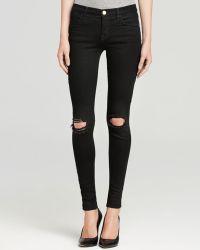 J Brand Jeans - Mid Rise Super Skinny Destruction In Blackout - Lyst