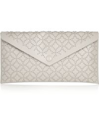 Alaïa Studded Leather Pouch - Lyst