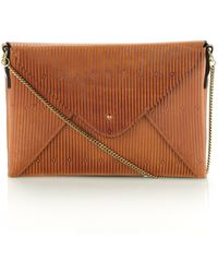 Lizzy Disney Tan Embossed Leather Bag - Lyst