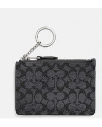 Coach Mini Skinny in Embossed Signature Canvas - Lyst