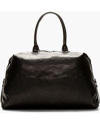 Ann Demeulemeester - Black Leather Side Strap Duffle Bag - Lyst