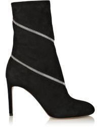 Alaïa Zipped Suede Ankle Boots black - Lyst