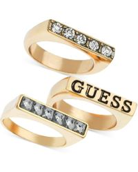Guess - Gold-tone Crystal Pavé Stick Logo Stone Ring Trio - Lyst