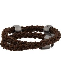 Alexander McQueen Woven Bracelet with Skull Charms - Lyst