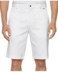 Calvin Klein Core Flat-Front Stretch Shorts white - Lyst