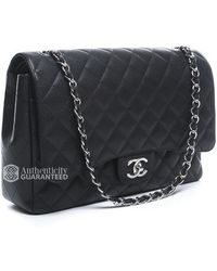 Chanel Pre-Owned Black Caviar Maxi Double Flap Bag - Lyst