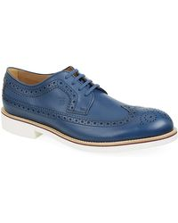 Tod's Contrast Sole Punched Leather Derby Shoe - Lyst