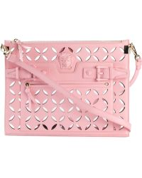 Versace Signature Perforated Medusa Clutch - Lyst