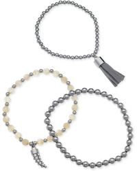 Guess - Silvertone Horn and Tassel Charm Beaded Stretch Bracelet Set - Lyst