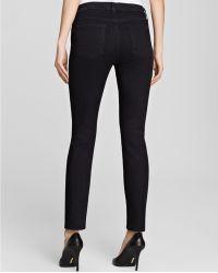 Jen7 - Skinny Jeans In Overdye Black - Lyst