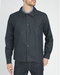 Gloverall Navy Short Waxed Raincoat - Lyst