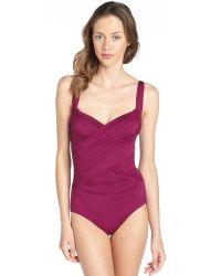 Badgley Mischka Wine Stretch Adjustable Draped Front Swimsuit - Lyst