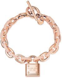 Michael Kors Rose Gold-Tone Padlock Logo Bracelet - Lyst