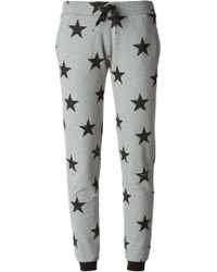 Moschino Star Print Trousers - Lyst
