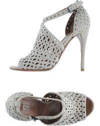 Alaïa White Sandals - Lyst