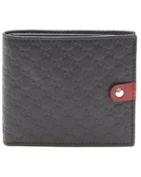 Gucci Black Gg Logo Embossed Leather Bi-Fold Wallet - Lyst