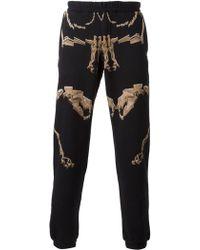 Marcelo Burlon County Of Milan Skeleton Print Track Pants - Lyst
