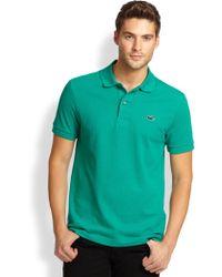 Lacoste PiquÉ Knit Rubber Logo Polo Shirt - Lyst