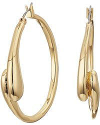 Robert Lee Morris - Shiny And Brushed Gold Tone Curved Hoop Earrings - Lyst