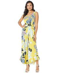 Eci - Floral Printed Sleeveless Ruffle Leg Hem Jumpsuit With Self Tie (yellow) Jumpsuit & Rompers One Piece - Lyst