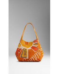 Burberry The Medium Canter In Book Cover Print orange - Lyst