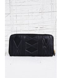 Urban Outfitters - Leather Embossed Zip Purse in Black - Lyst
