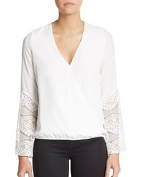 The Vanity Room - Lace Accented-knit Wrap Top - Lyst