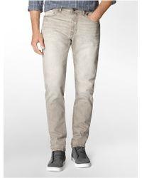 Calvin Klein Jeans Tapered Leg Cinder Wash Jeans gray - Lyst