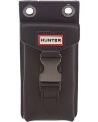 HUNTER - Rubberised Leather Black Phone Pouchette - Lyst