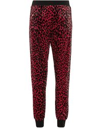 Juicy Couture Leopard Tapered Track Pants - Lyst