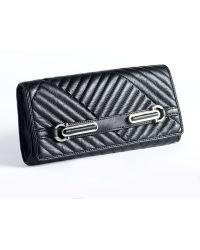 Calvin Klein Quilted Leather Handstrap Clutch - Lyst