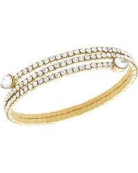Swarovski Gold Tone and Crystal Twisted Bangle Bracelet - Lyst