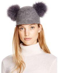 Bettina - Wool Cap With Fox Fur Pom-poms - Lyst