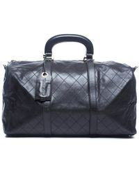 Chanel Preowned Black Lambskin Quilted Medium Duffle Bag - Lyst