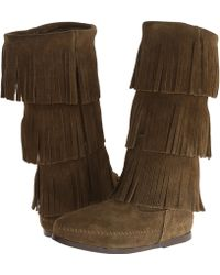 Minnetonka 3 Layer Fringe Boot - Lyst