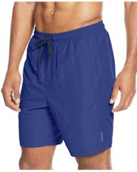 Calvin Klein Solid Swim Trunks blue - Lyst