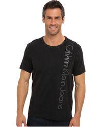 Calvin Klein Jeans Vertical Print Logo Ss Tshirt - Lyst
