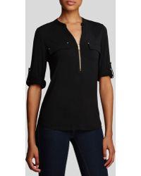 Calvin Klein Zip Front Roll Sleeve Knit Blouse black - Lyst